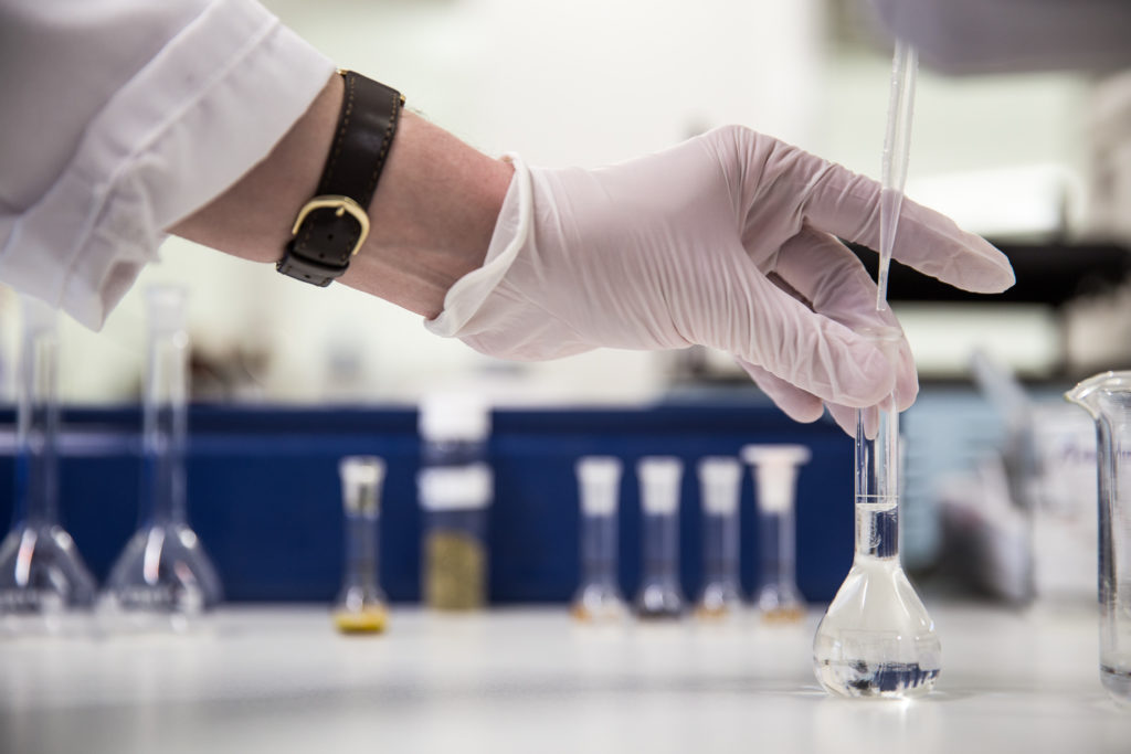 hands in a lab doing testing
